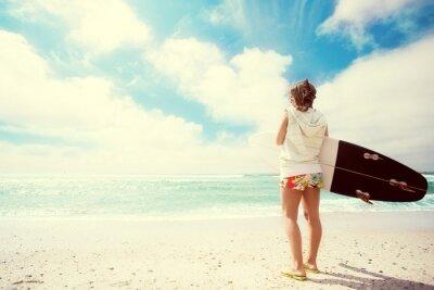 Canvas print Surfer girl on the beach