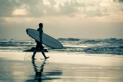 Canvas print surfer silhouette during sunset