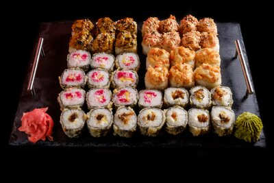Canvas print sushi on a black background