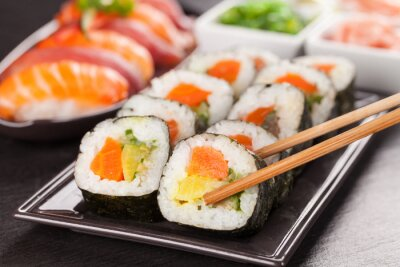 Canvas print sushi pieces with chopsticks