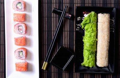 Canvas print Sushi rolls on a platter