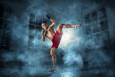 Canvas print The young  man kickboxing