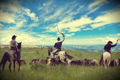 Canvas print Three cowboys drive herd of horses , toning, vignetting