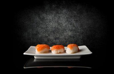 Canvas print Three sushi on black