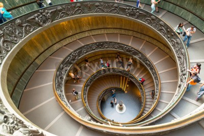 Tourists walk down the famous spiral staircase in Vatican Museum.