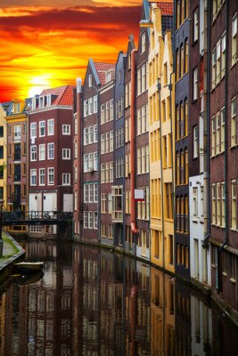 Canvas print Traditional old buildings in Amsterdam
