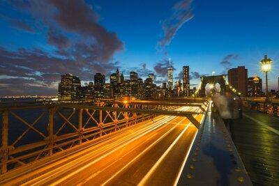 Canvas print Traffic on Brooklyn bridge in New York at dusk