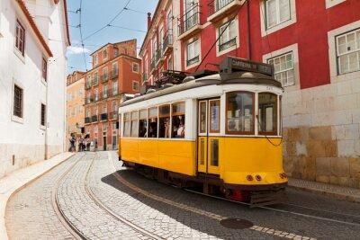Canvas print tram on narrow street of Alfama, Lisbon