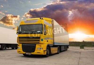 Canvas print Truck - cargo transportation with sun