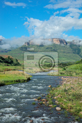 Tugela river against a backdrop of the Drakensberg Mountains, South Africa.