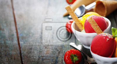 Canvas print Two Ice cream scoops in bowls with wafer