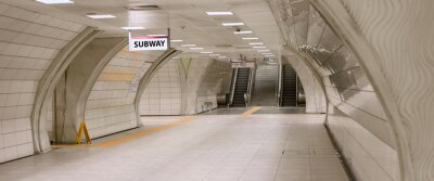 Canvas print Underground subway station hallway tunnel with escalator. Abstract perspective view
