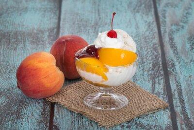 Canvas print Vanilla peach melba ice cream with peach fruits on wooden vintag