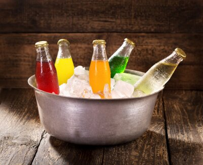 Canvas print various bottles of soda in the bucket with ice