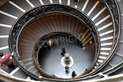VATICAN CITY, VATICAN STATE - MARCH 15, 2016: People descend the modern double helix staircase designed by Giuseppe Momo in 1932, Vatican Museums