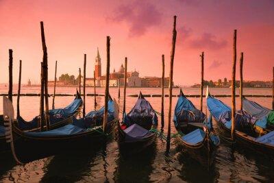 Canvas print Venice with famous gondolas at gentle pink sunrise light,