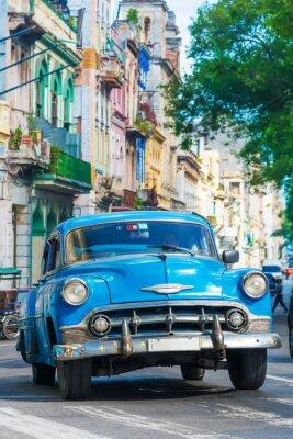 Canvas print Vintage american car on a street in downtown Havana