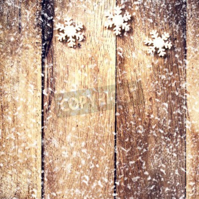 Vintage Christmas Card with white snowflakes and falling snow. Christmas decoration over wooden background with copy space for greeting text.
