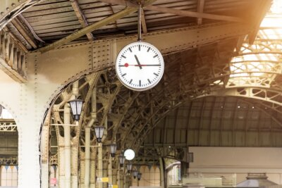 Canvas print Vintage clock on train station with building roof.