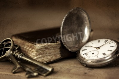 Canvas print Vintage grunge still life with pocket watch, and old book and brass keys