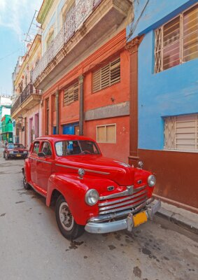 Canvas print Vintage red car on the street of old city, Havana, Cuba