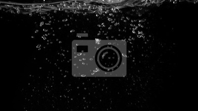 Water bubbles floating on black background with oil paint effect which represent refreshing of refreshment from soda or carbonated drink and power of liquid that splashing by air pump.