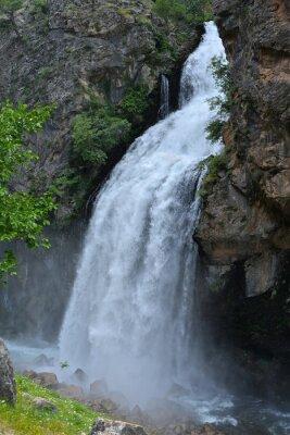 Canvas print Waterfall  follows from high cliff