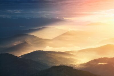 Canvas print When a Night Becomes a Day. Beautiful hills brightly lit during the sunrise.