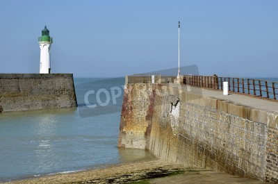White and green lighthouse and sea wall of Saint valéry en Caux, commune in the Seine-Maritime department in the Haute-Normandie region in northwestern France