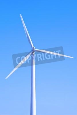 Wind turbine set against a blue sky
