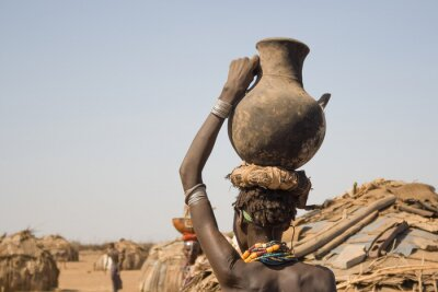 Canvas print Woman carries on her head a container with water, Ethiopia
