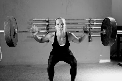 Canvas print woman on a weightlifting session - crossfit workout.