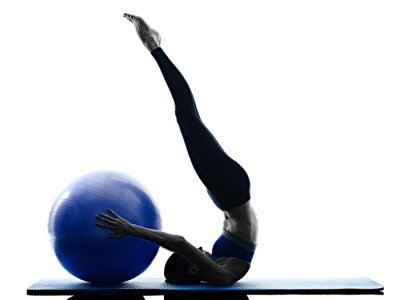 Canvas print woman pilates ball exercises fitness isolated