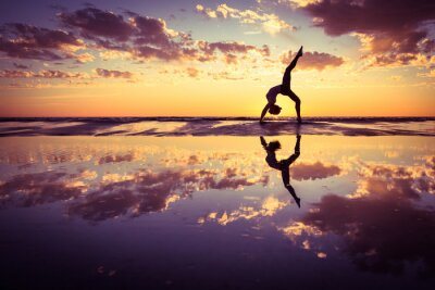 Canvas print woman practicing yoga