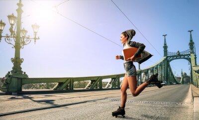 Canvas print Woman running to school