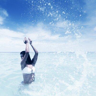 Canvas print Woman splashing in sea