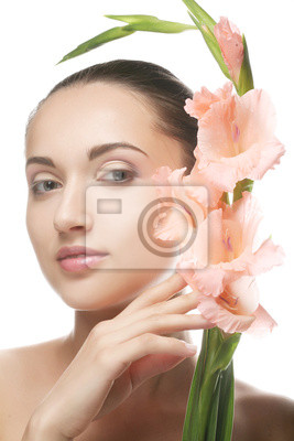 woman with gladiolus flowers in her hands