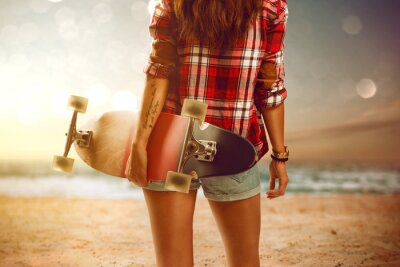 Canvas print Woman with longboard at the beach