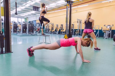 Canvas print Women group training in a crossfit circuit