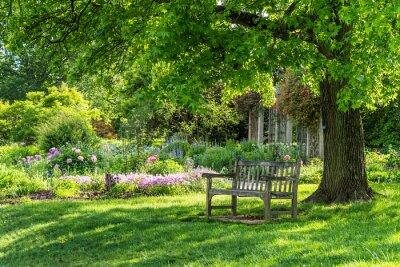 Canvas print wooden bench at flower garden park