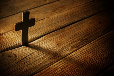 Canvas print wooden cross on wood background