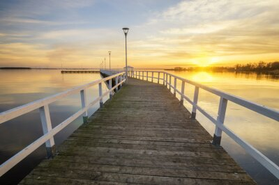 Canvas print wooden, white pier on the bay at sunset
