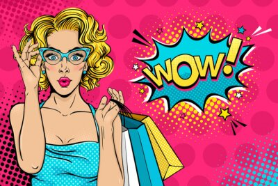 Canvas print Wow female face. Sexy surprised young woman in glasses with open mouth and blonde curly hair holding shopping bags and Wow! speech bubble. Vector bright background in pop art retro comic style.