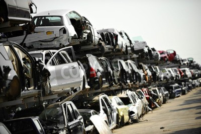 Canvas print Wrecked vehicles are seen in a car junkyard