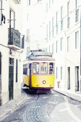 Canvas print yellow ancient tram on streets of Lisbon, Portugal