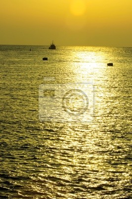 yellow sunset on sea with ship
