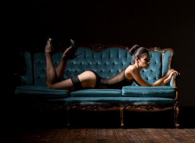 Canvas print Young and sexy woman in lingerie on a vintage sofa