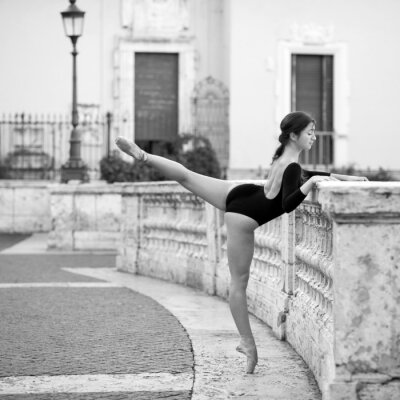 Canvas print Young beautiful ballerina dancing on the Spanish Steps in Rome,