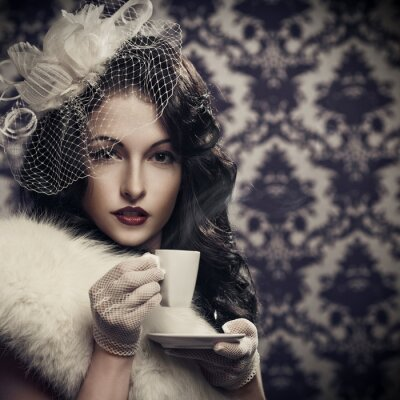 Canvas print Young beautiful retro lady drinking coffee