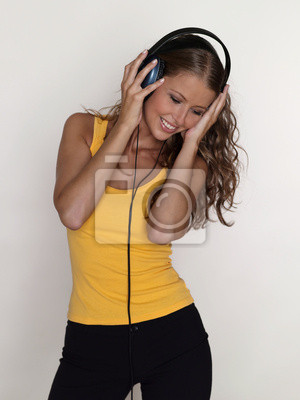 Young, beautiful woman listening to the music